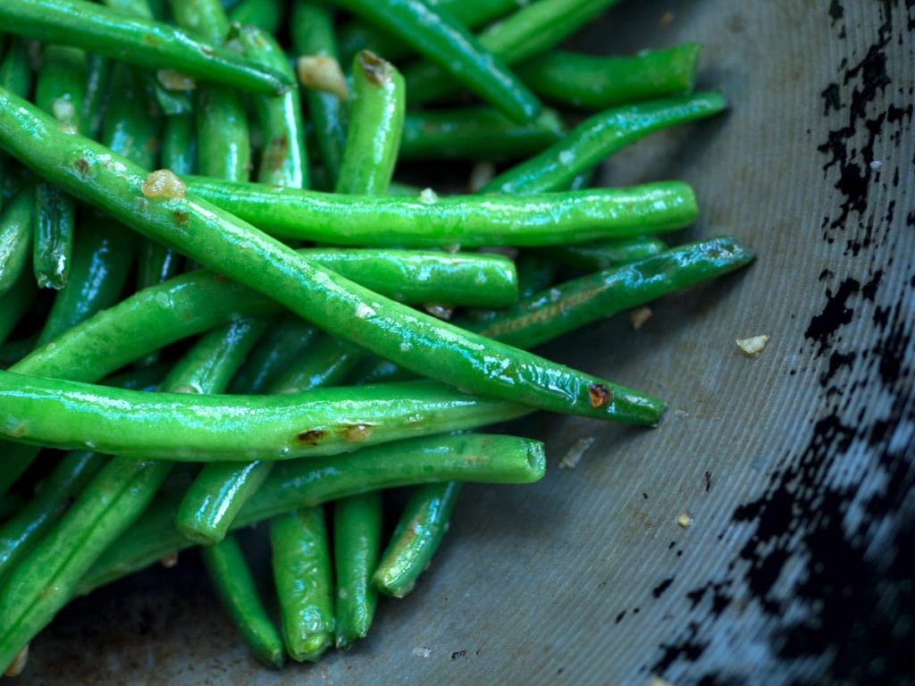 Close up of green beans in wok