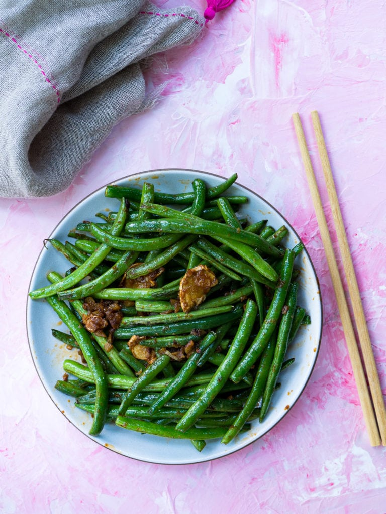 Green Beans with chopsticks and grey napkin