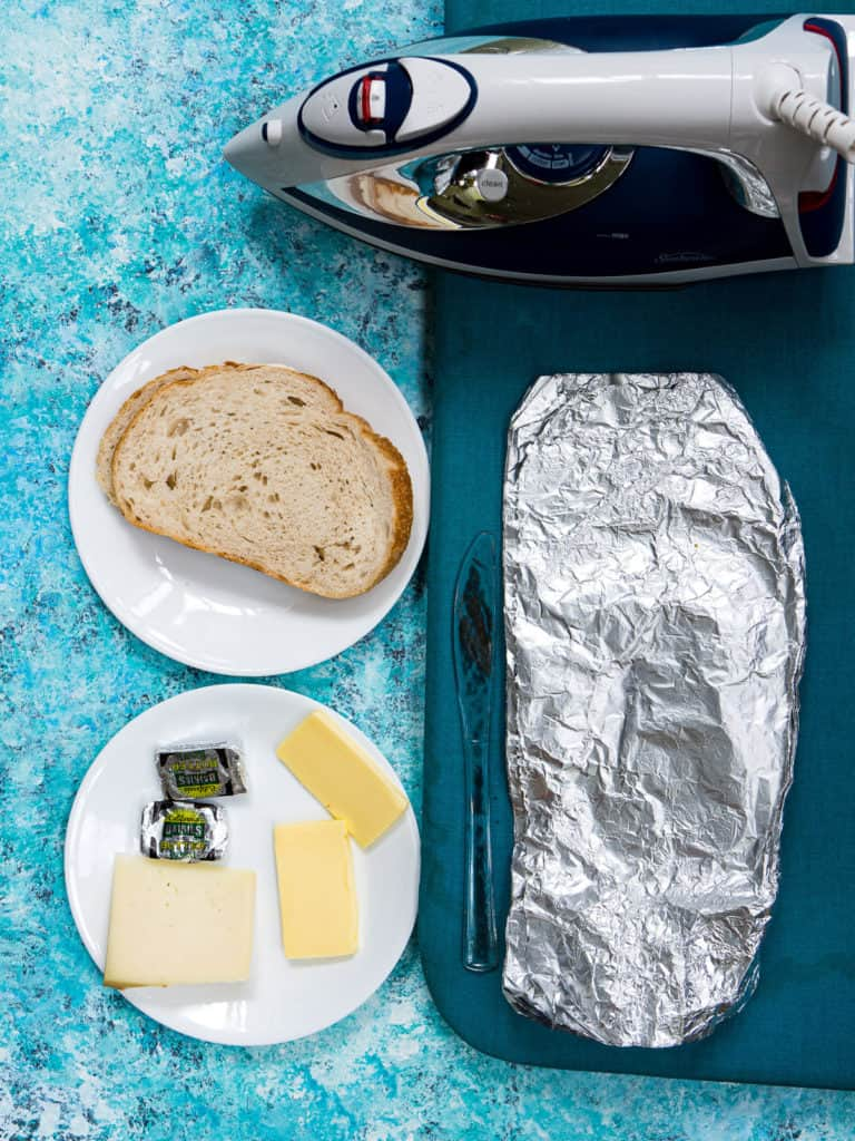 The ingredients and equipment needed to make a grilled cheese sandwich in a hotel room