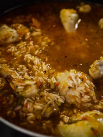 Extreme close up shot of jambalaya stew with liquid cooking. Recipe from garlicdelight.com.