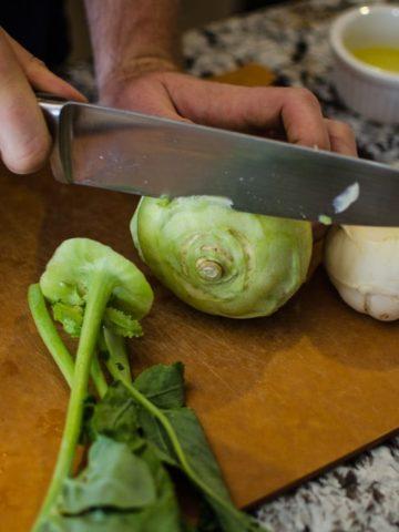 Cut the tops off the kohlrabi.