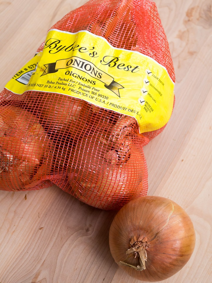 A bag of onions in its original mesh bag