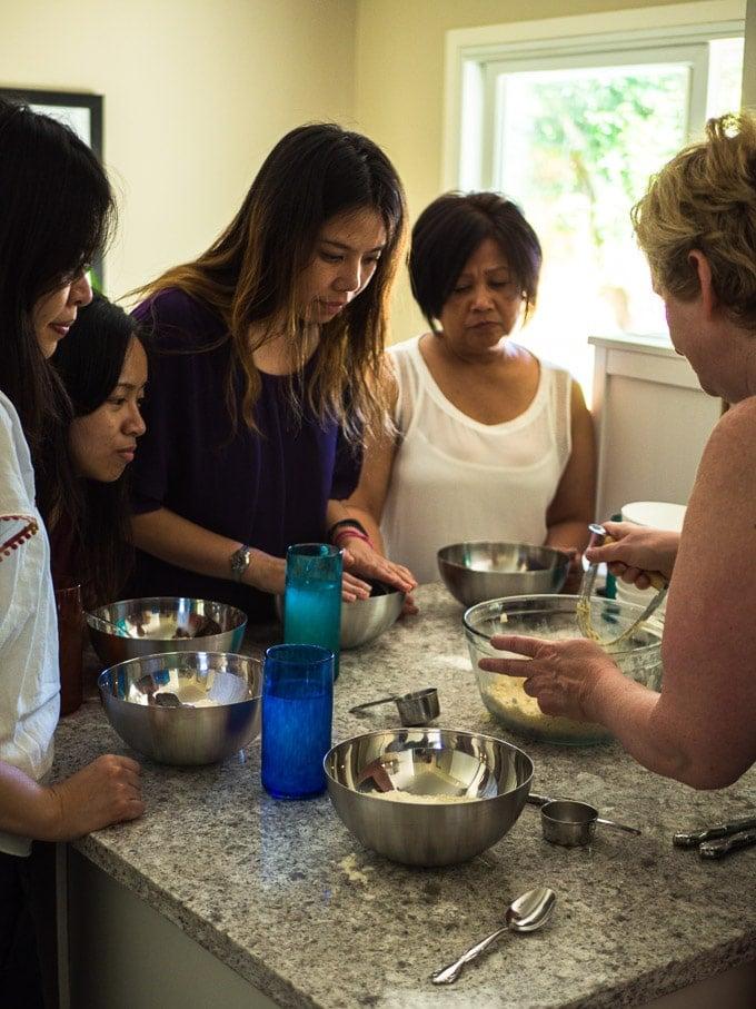 Pie crust making group watching Doreen measure ingredients