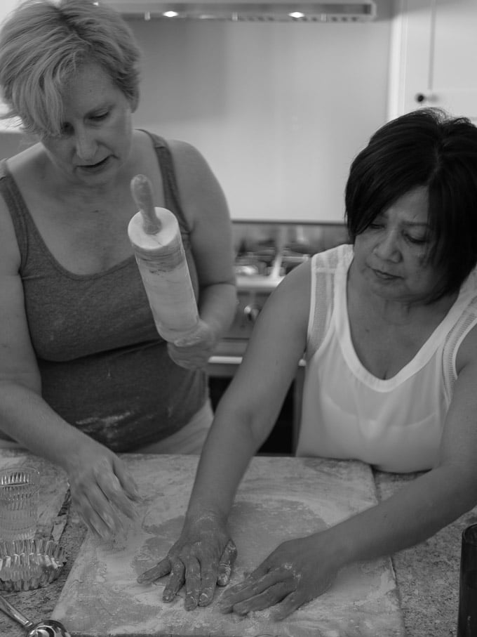 Priscilla and Doreen rolling out a pie crust