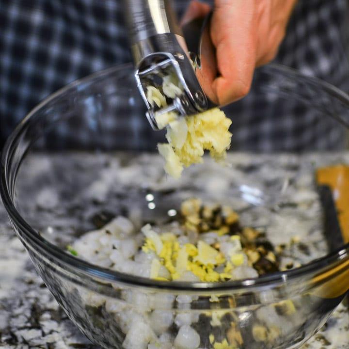 Squeeze garlic with a garlic press