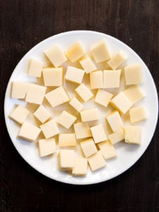 Cubes of cheese on a white plate