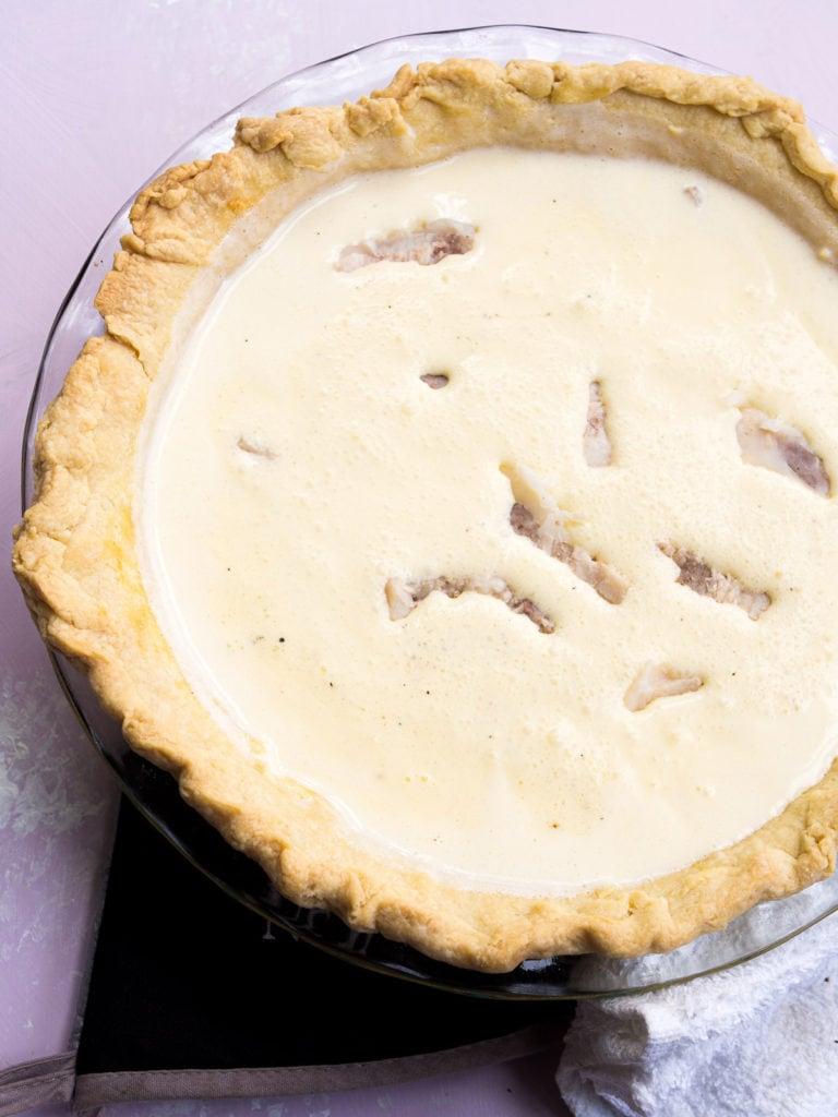 Uncooked quiche lorraine with lardons added