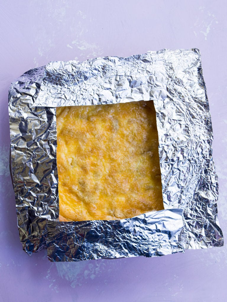 A quiche lorraine tented with aluminium foil