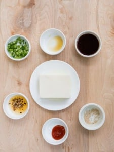 Ingredients for Silken Tofu Green Onion recipe on wood background