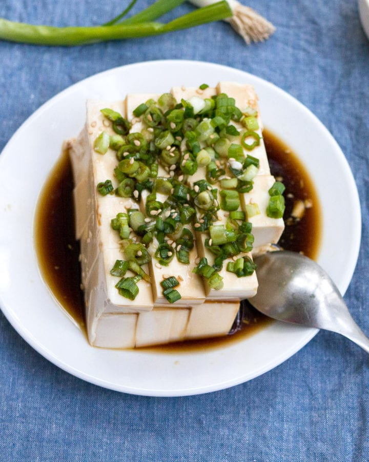 Silken Tofu with Green Onion recipe on a white plate featured image