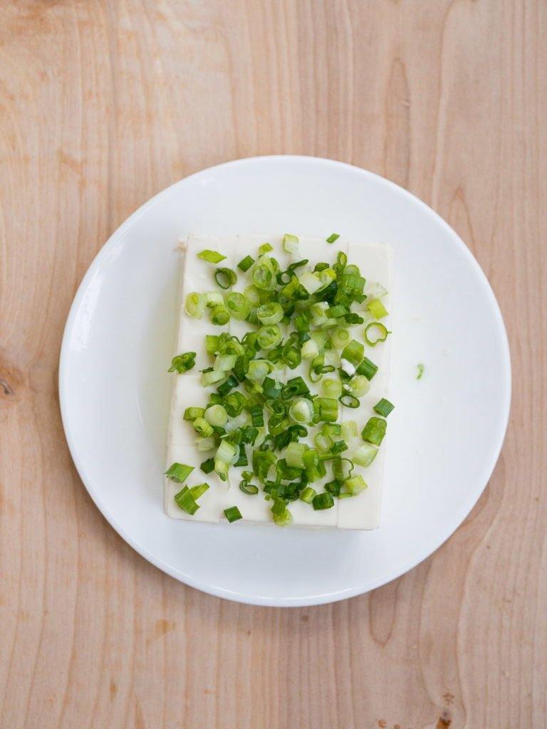 Block of silken tofu with chopped green onions