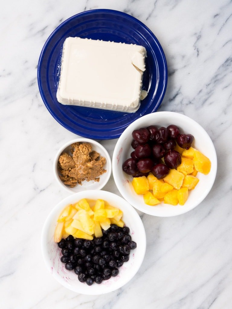 The ingredients for a fruit smoothie made with silken tofu
