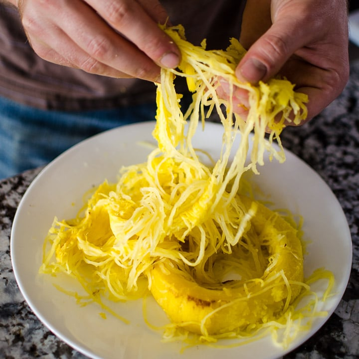 Separate the strands of spaghetti squash from each other.