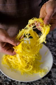 Gently push and pull the squash strands