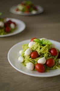 Pesto Spaghetti Squash with Mozzarella & Cherry Tomatoes