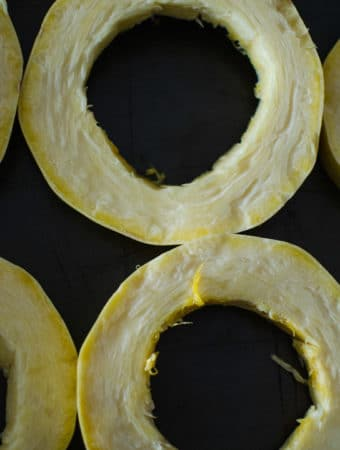 Place the spaghetti squash rings into baking trays.