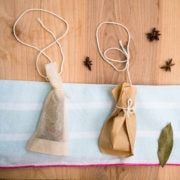 A teabag and coffee filter spice sachet on a napkin