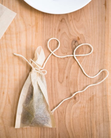 A spice sachet made with a tea filter bag with extra long twine