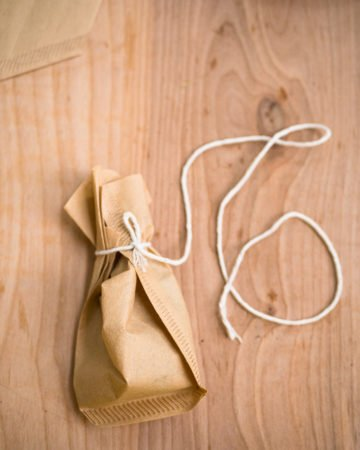 A spice sachet made with a coffee filter with extra long twine