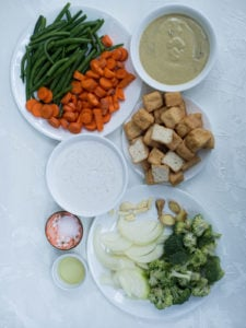 Ingredients for Thai Green Curry with Tofu and Vegetable on a white background