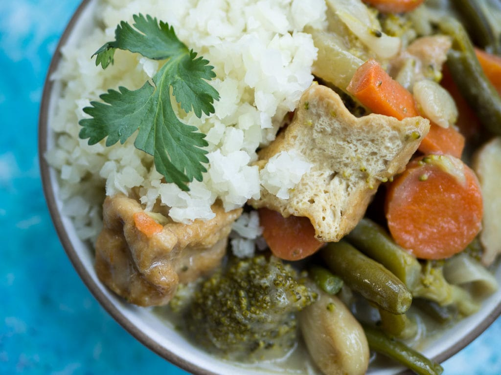 Close up look of Thai Green Curry with Tofu and Vegetable in white bowl