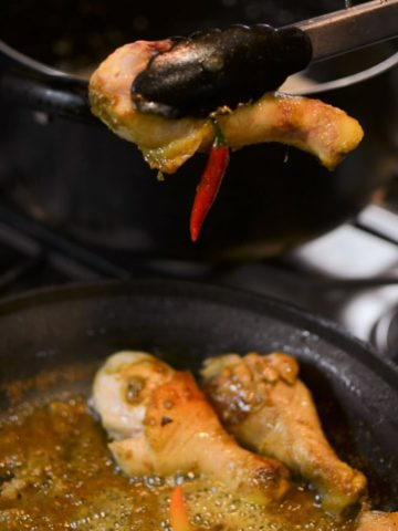 Transfer the chicken to the large pot with the coconut cream