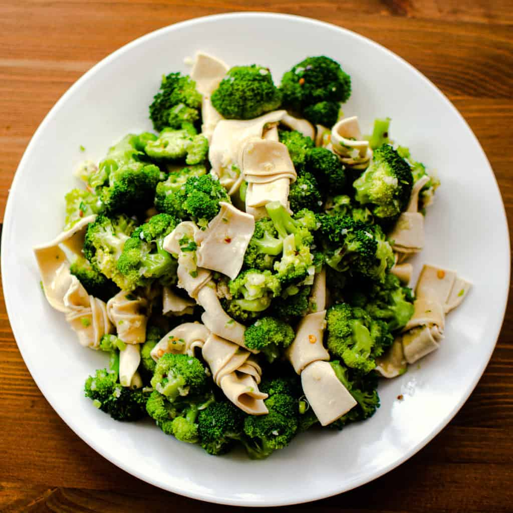Tofu and broccoli salad dressed with spicy garlic-green onion sauce
