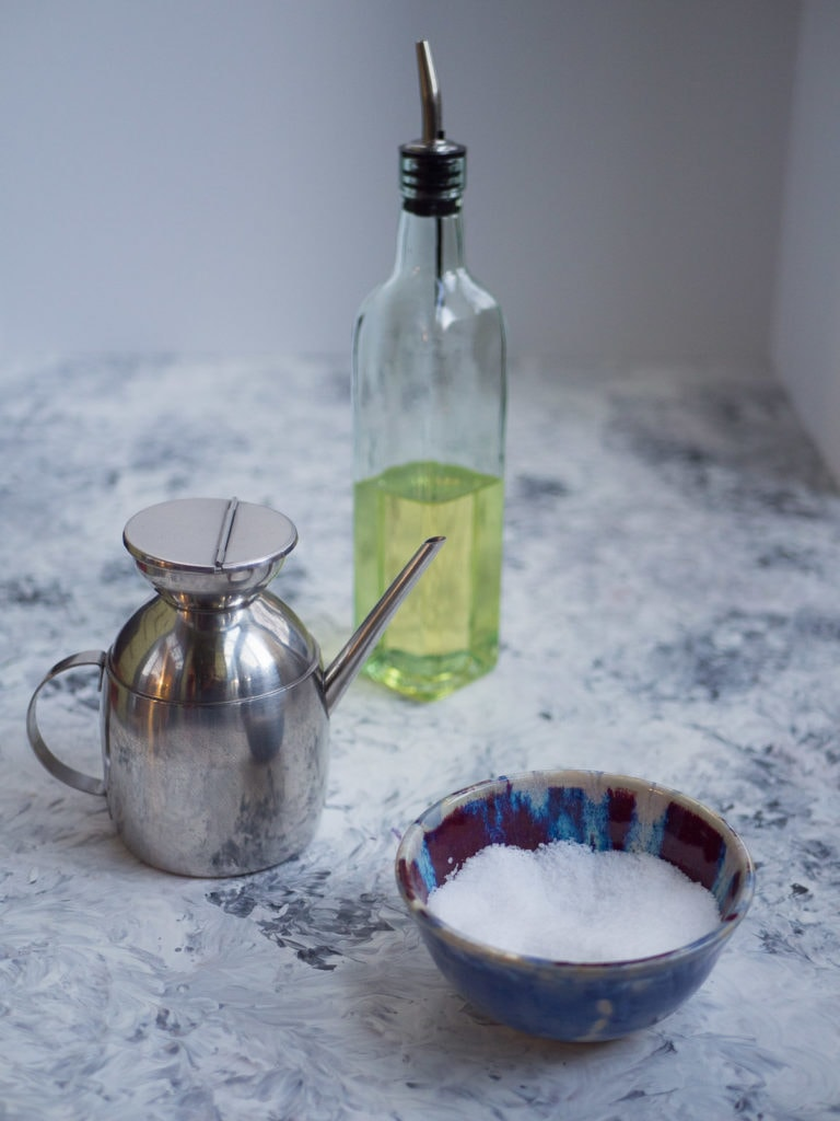 Oil and salt in small containers