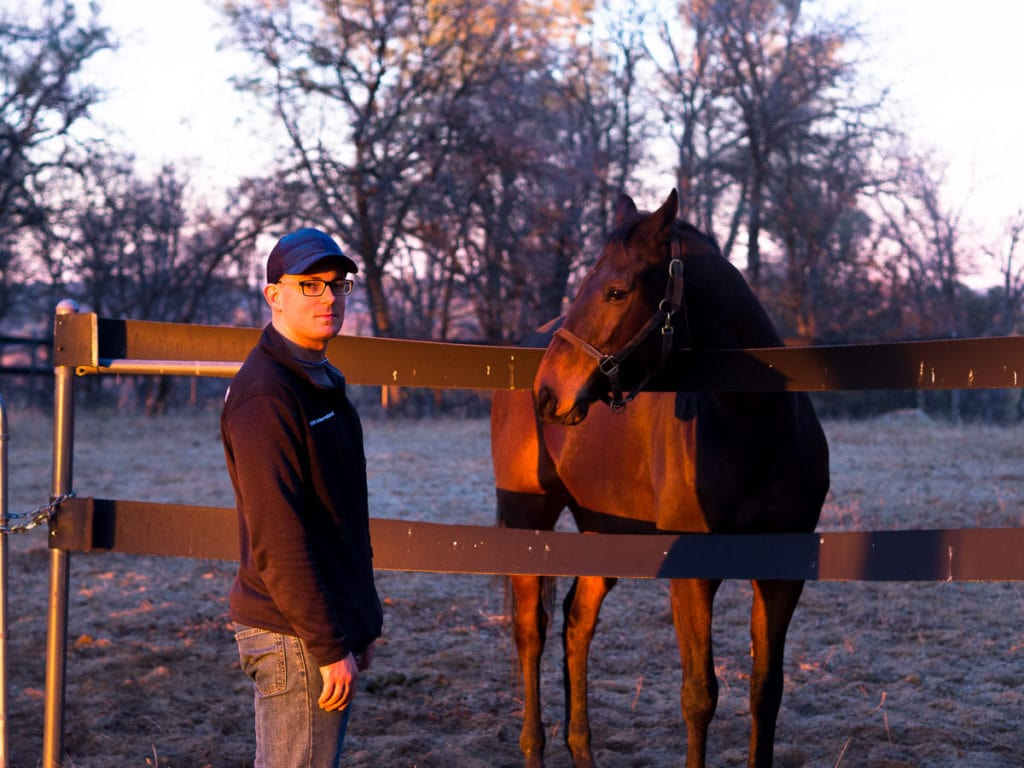 Alex next to Bobby, the racehorse