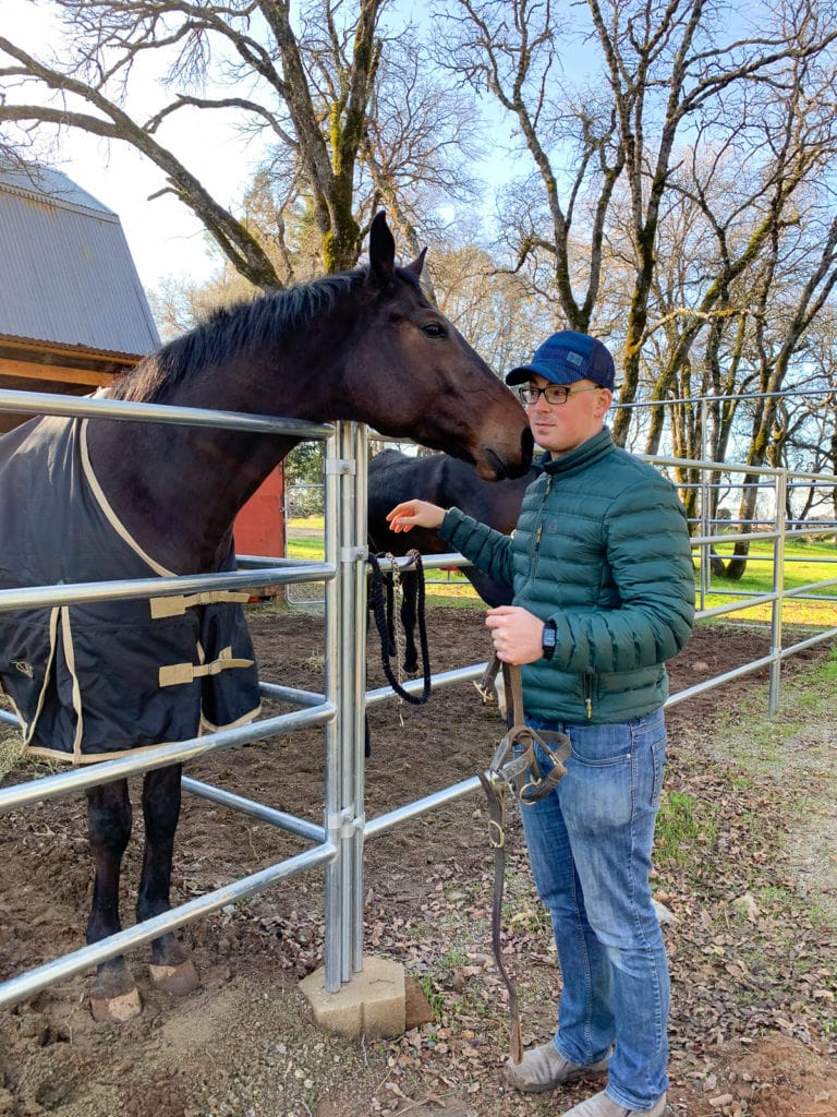 Alex with Bobby, the racehorse, in his pen