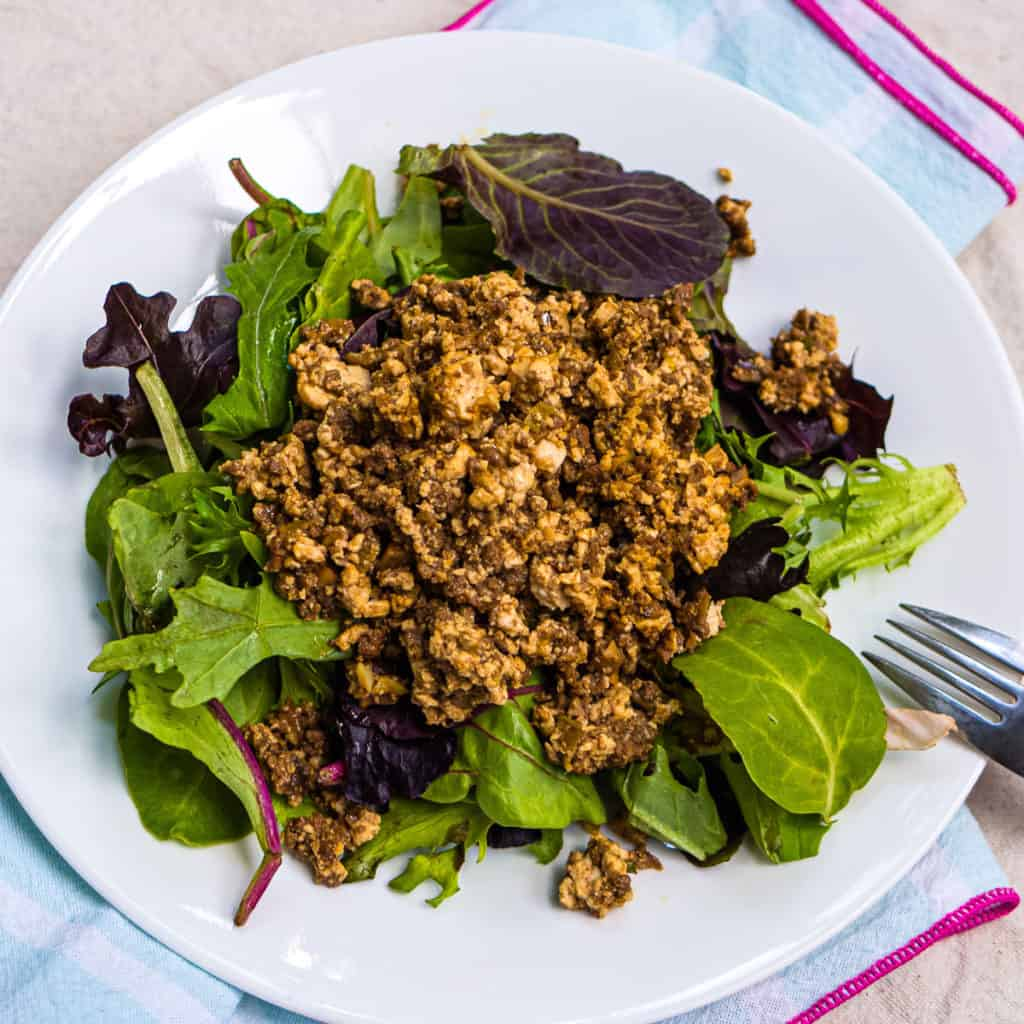 Kari's shiitake mushroom meat sauce with tofu on a bed of salad greens